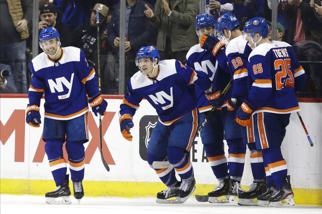 New York Islanders' Mathew Barzal, second from left, celebrates with teammates after scoring a goal during the third period of an NHL hockey game against the Dallas Stars Tuesday, Feb. 4, 2020, in New York. The Islanders won 4-3. (AP Photo/Frank Franklin II)
