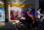 Walls of the Assumption convent are decorated with posters of Pope Francis in Bangkok, Thailand, Wednesday, Nov. 20, 2019. Pope Francis arrives in Thailand on Wednesday for the first visit here by the head of the Roman Catholic Church since St. John Paul II in 1984. (AP Photo/Gemunu Amarasinghe)