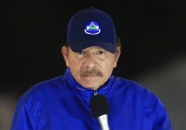 FILE - In this March 21, 2019 file photo, Nicaragua's President Daniel Ortega speaks during the inauguration ceremony of a highway overpass in Managua, Nicaragua. The Central American nation's National Assembly approved a controversial law Thursday, Oct. 15, 2020, that would give the government of President Ortega more power to monitor people, businesses and organizations that receive funding from overseas. (AP Photo/Alfredo Zuniga, File)