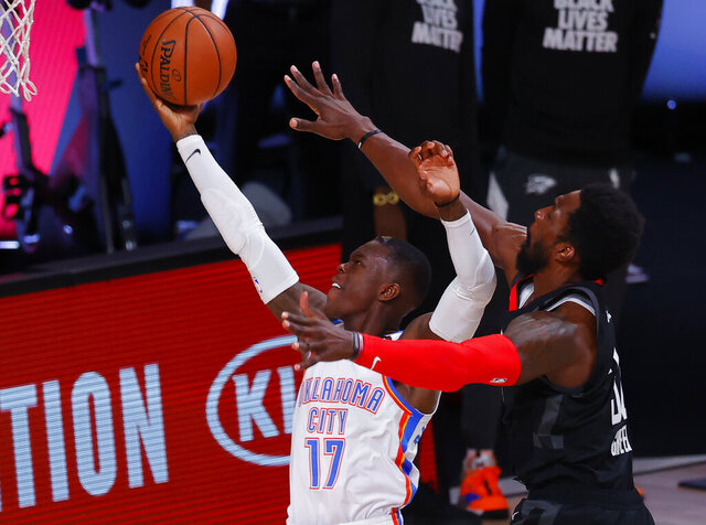 Oklahoma City Thunder's Dennis Schroder (17) scores against Houston Rockets' Jeff Green, right, during the second quarter of Game 4 of an NBA basketball first-round playoff series, Monday, Aug. 24, 2020, in Lake Buena Vista, Fla. (Kevin C. Cox/Pool Photo via AP)