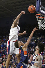 Gonzaga forward Brandon Clarke, top, blocks a shot by Pepperdine forward Kessler Edwards, center, in front of Gonzaga guard Josh Perkins during the second half of an NCAA college basketball game in Spokane, Wash., Thursday, Feb. 21, 2019. (AP Photo/Young Kwak)