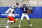 BYU quarterback Zach Wilson (1) throws downfield as UTSA linebacker Trevor Harmanson (15) defends in the first half during an NCAA college football game Saturday, Oct. 10, 2020, in Provo, Utah. (AP Photo/Rick Bowmer, Pool)
