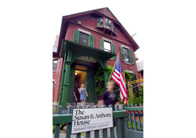 FILE - In this July 28, 2004, file photo, tourists exit the Susan B. Anthony House after taking a tour of the house in Rochester, N.Y. Fire officials in Rochester were investigating a fire that damaged the house early Sunday, Sept. 26, 2021. (AP Photo/David Duprey, File)