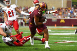 Minnesota running back Trey Potts scores a touchdown on a four yard run against Miami Ohio during the first half of an NCAA college football game on Saturday, Sept. 11, 2021, in Minneapolis. (AP Photo/Craig Lassig)