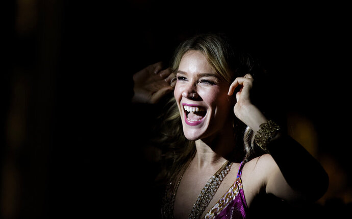 ADDS DETAIL TO BACKGROUND, FILE - In this Nov. 26, 2016 file photo, British singer Joss Stone laughs as she adjusts her earpiece before performing a concert in Karen, on the outskirts of Nairobi, Kenya. Stone says Wednesday, July 3, 2019, that she was deported from Iran after arriving in the Islamic Republic as part of a worldwide concert tour, even though she didn't plan to perform there.(AP Photo/Ben Curtis, File)
