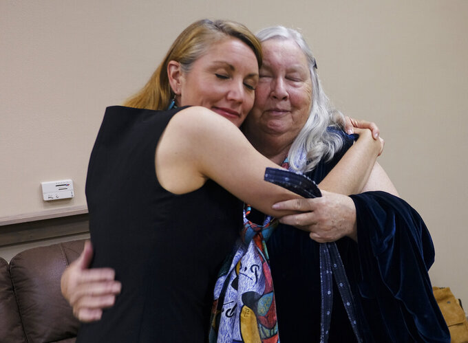 Democratic candidate Melanie Stansbury, left, hugs her mother, Sunny Birklund, at the Hotel Albuquerque as results come in for the New Mexico 1st Congressional District special election to fill former U.S. Rep. Deb Haaland's seat, Tuesday, June 1, 2021, in Albuquerque, N.M. Haaland resigned her seat to become United States Secretary of the Interior. (Adolphe Pierre-Louis/The Albuquerque Journal via AP)
