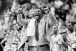 "FILE - In this March 30, 1985, file photo, Georgetown coach John Thompson shouts to the floor during the Hova's NCAA semifinal game against St. John's at Rudo Arena in Lexington, Ky. John Thompson, the imposing Hall of Famer who turned Georgetown into a ""Hoya Paranoia"" powerhouse and became the first Black coach to lead a team to the NCAA men's basketball championship, has died. He was 78 His death was announced in a family statement Monday., Aug. 31, 2020. No details were disclosed. (AP Photo/File)"