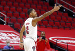North Carolina State's Shakeel Moore (2) celebrates making a 3-pointer of an NCAA college basketball game against North Carolina in Raleigh, N.C., Tuesday, Dec. 22, 2020. (Ethan Hyman/The News & Observer via AP)
