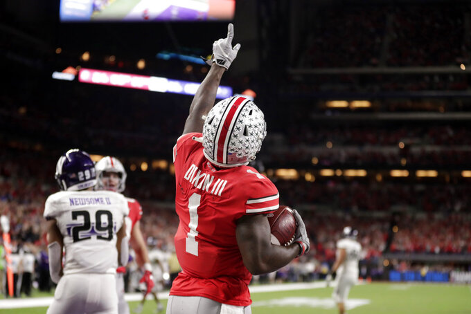 Ohio State wide receiver Johnnie Dixon (1) celebrates a touchdown during the second half of the Big Ten championship NCAA college football game against Northwestern, Saturday, Dec. 1, 2018, in Indianapolis. (AP Photo/Michael Conroy)