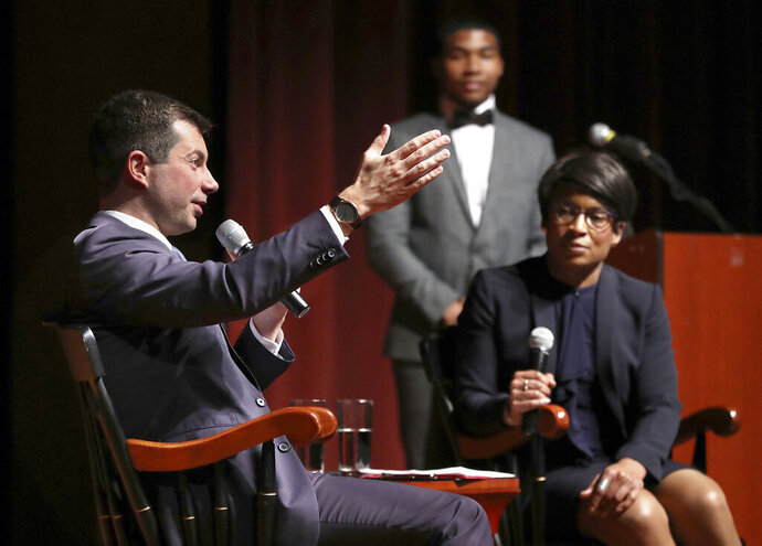 Presidential hopeful Pete Buttigieg, Mayor of South Bend, Ind., holds a conversation with Dr. Adrienne Jones, right, at Morehouse College on Monday, Nov. 18, 2019, in Atlanta. (Curtis Compton/Atlanta Journal-Constitution via AP)