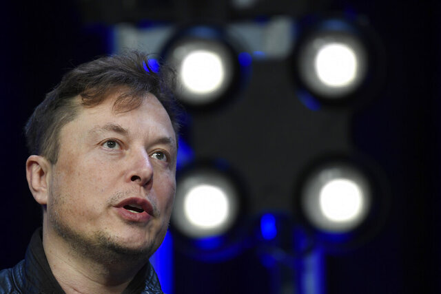 FILE - In this March 9, 2020, file photo, Tesla and SpaceX Chief Executive Officer Elon Musk speaks at the SATELLITE Conference and Exhibition in Washington. Musk is threatening to pull the company's factory and headquarters out of California in an escalating spat with local officials over reopening an electric vehicle plant. On Twitter Saturday afternoon, May 9, 2020. Musk also threatened to sue over Health Department coronavirus restrictions that have stopped Tesla from restarting production at its factory in Fremont south of San Francisco. (AP Photo/Susan Walsh, File)