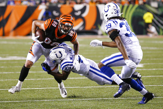 Cincinnati Bengals tight end Jordan Franks (88) is tackled by Indianapolis Colts defensive back Rolan Milligan (42) during the second half of an NFL preseason football game Thursday, Aug. 29, 2019, in Cincinnati. (AP Photo/Gary Landers)