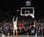 Virginia's Kyle Guy (5) shoots the last free throw to defeat Auburn 63-62 during the second half in the semifinals of the Final Four NCAA college basketball tournament, Saturday, April 6, 2019, in Minneapolis. (AP Photo/Jeff Roberson)
