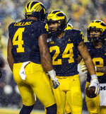 Michigan running back Zach Charbonnet (24) celebrates his touchdown with wide receiver Nico Collins (4) in the second quarter of an NCAA college football game against Notre Dame in Ann Arbor, Mich., Saturday, Oct. 26, 2019. (AP Photo/Tony Ding)