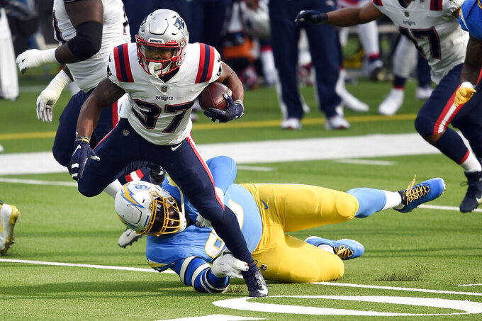New England Patriots running back Damien Harris runs against the Los Angeles Chargers during the first half of an NFL football game Sunday, Dec. 6, 2020, in Inglewood, Calif. (AP Photo/Kelvin Kuo)