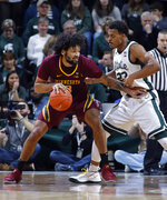 Minnesota's Jordan Murphy, left, maneuvers against Michigan State's Xavier Tillman during the first half of an NCAA college basketball game, Saturday, Feb. 9, 2019, in East Lansing, Mich. Michigan State won 79-55. (AP Photo/Al Goldis)