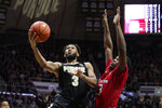 Purdue guard Jahaad Proctor (3) shoots in front of Rutgers guard Montez Mathis (23) during the second half of an NCAA college basketball game in West Lafayette, Ind., Saturday, March 7, 2020. Rutgers defeated Purdue 71-68 in overtime. (AP Photo/Michael Conroy)