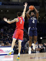 Villanova forward/guard Eric Paschall, right, shoots against DePaul forward Jaylen Butz during the first half of an NCAA college basketball game Wednesday, Jan. 30, 2019, in Chicago. (AP Photo/Nam Y. Huh)