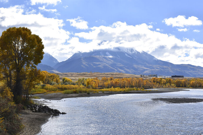 FILE - In this Oct. 8, 2018 file photo, emigrant Peak is seen rising above the Paradise Valley and the Yellowstone River near Emigrant, Mont. The Trump administration has put a conservative advocate who argues for selling off the nation's public lands in charge of the nation's 250 million public acres. Interior Secretary David Bernhardt on Monday signed an order making William Perry Pendley acting head of the Bureau of Land Management, putting the lawyer and Wyoming native in charge of public lands and their resources.  (AP Photo/Matthew Brown)