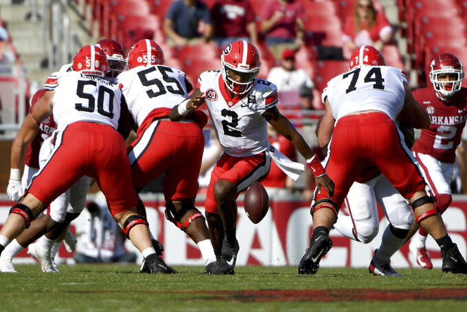 Georgia quarterback D'Wan Mathis (2) tires to pick up his fumble during the first half of an NCAA college football game against Arkansas in Fayetteville, Ark., Saturday, Sept. 26, 2020. (AP Photo/Michael Woods)