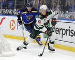 Minnesota Wild's Luke Johnson (41) controls the puck as he is pursued by St. Louis Blues' Sammy Blais (9) during the second period of an NHL hockey game Thursday, May 13, 2021, in St. Louis. (AP Photo/Tom Gannam)