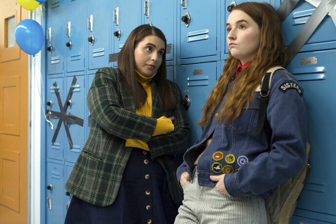 This image released by Annapurna Pictures shows Beanie Feldstein, left, and Kaitlyn Dever in a scene from the film