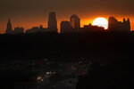 The sun sets beyond downtown Kansas City, Mo., Saturday, June 27, 2020. Thousands of census takers are about to begin the most labor-intensive part of America's once-a-decade headcount. The first visits will be focused on six locations — West Virginia, Idaho, Maine, Kansas City, New Orleans and the Oklahoma City area. (AP Photo/Charlie Riedel)