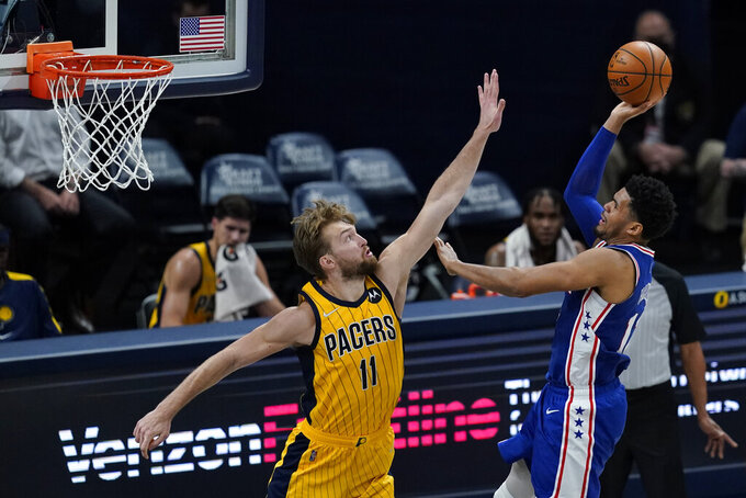 Philadelphia 76ers' Tobias Harris (12) shoots over Indiana Pacers' Domantas Sabonis (11) during the second half of an NBA basketball game, Tuesday, May 11, 2021, in Indianapolis. (AP Photo/Darron Cummings)