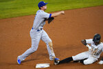 Los Angeles Dodgers shortstop Corey Seager, left, throws over Colorado Rockies' Raimel Tapia after forcing him out at second base on a ground ball hit by Charlie Blackmon, who was safe during the sixth inning of a baseball game Thursday, Sept. 17, 2020, in Denver. (AP Photo/David Zalubowski)
