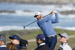 Dustin Johnson hits from the seventh tee of the Monterey Peninsula County Club Shore Course during the second round of the AT&T Pebble Beach National Pro-Am golf tournament Friday, Feb. 7, 2020, in Pebble Beach, Calif. (AP Photo/Tony Avelar)