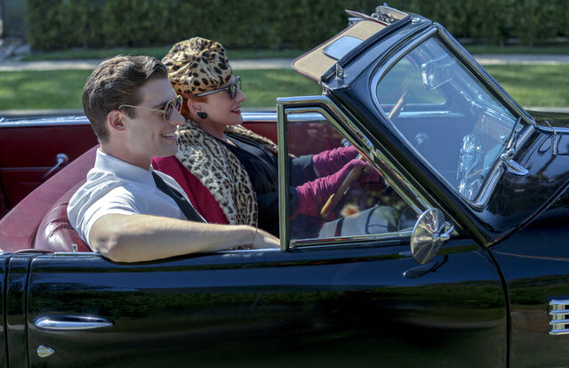 This image released by Netflix shows David Corenswet, left, and Patti LuPone in a scene from
