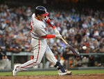 Washington Nationals' Kurt Suzuki connects for a two-run home run off San Francisco Giants pitcher Conner Menez in the third inning of a baseball game Tuesday, Aug. 6, 2019, in San Francisco. (AP Photo/Ben Margot)
