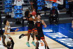 Oregon State guard Ethan Thompson (5) drives on Oklahoma State forward Matthew-Alexander Moncrieffe (12) during the second half of a men's college basketball game in the second round of the NCAA tournament at Hinkle Fieldhouse in Indianapolis, Sunday, March 21, 2021. (AP Photo/Paul Sancya)