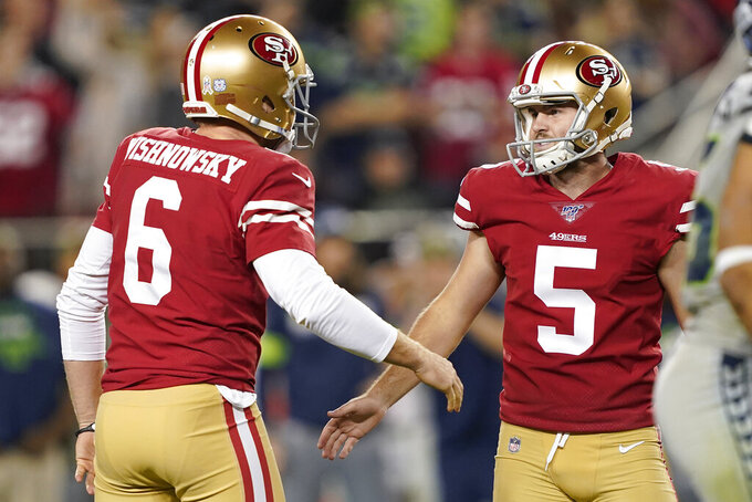 San Francisco 49ers kicker Chase McLaughlin (5) celebrates with Mitch Wishnowsky after kicking a field goal during the second half of an NFL football game against the Seattle Seahawks in Santa Clara, Calif., Monday, Nov. 11, 2019. (AP Photo/Tony Avelar)