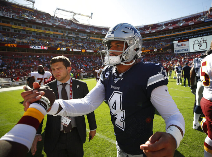 Dallas Cowboys quarterback Dak Prescott (4) greets Washington Redskins players on the field at the end of the NFL football game, Sunday, Sept. 15, 2019, in Landover, Md. Dallas won 31-21. (AP Photo/Alex Brandon)