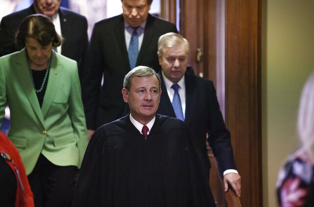 Chief Justice of the United States John Roberts, followed by Sen. Dianne Feinstein, D-Calif., left, and Senate Judiciary Committee Chairman Lindsey Graham, R-S.C., leaves the Senate chamber after presiding over the impeachment trial and today's acquittal of President Donald Trump, at the Capitol in Washington, Wednesday, Feb. 5, 2020. (AP Photo/J. Scott Applewhite)