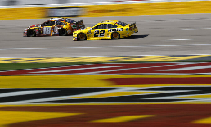 Kyle Busch (18) and Joey Logano (22) drive during a NASCAR Cup Series auto race at the Las Vegas Motor Speedway, Sunday, March 3, 2019, in Las Vegas. (AP Photo/John Locher)
