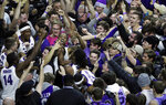 Kansas State players celebrate with fans following an NCAA college basketball game against Kansas in Manhattan, Kan., Tuesday, Feb. 5, 2019. Kansas State defeated Kansas 74-67. (AP Photo/Orlin Wagner)