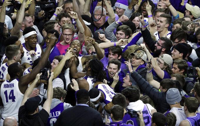 Kansas State players celebrate with fans following an NCAA college basketball game against Kansas in Manhattan, Kan., Tuesday, Feb. 5, 2019. Kansas State defeated Kansas 74-67. (AP Photo/Orlin Wagner)