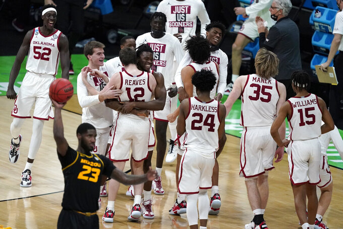 Oklahoma players celebrate after a first-round game against Missouri in the NCAA men's college basketball tournament at Lucas Oil Stadium, Saturday, March 20, 2021, in Indianapolis. Oklahoma won 72-68. (AP Photo/Darron Cummings)