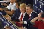 "FILE - In this Oct. 27, 2019, file photo Sen. David Perdue, R-Ga., takes a selfie with President Donald Trump during the seventh inning of Game 5 of the baseball World Series between the Houston Astros and the Washington Nationals in Washington. ""Bring it on,"" Perdue spokesperson Casey Black said of any efforts to attack Perdue's closeness with Trump.  (AP Photo/Pablo Martinez Monsivais, File)"