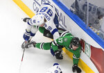 Tampa Bay Lightning defenseman Mikhail Sergachev (98) checks Dallas Stars right wing Nick Caamano (17) during the first period of Game 3 of the NHL hockey Stanley Cup Final, Wednesday, Sept. 23, 2020, in Edmonton, Alberta. (Jason Franson/The Canadian Press via AP)