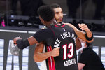 Miami Heat's Bam Adebayo (13) hugs Boston Celtics' Jayson Tatum, right, after the Heat's win over the Celtics in a NBA conference final playoff basketball game Sunday, Sept. 27, 2020, in Lake Buena Vista, Fla. (AP Photo/Mark J. Terrill)