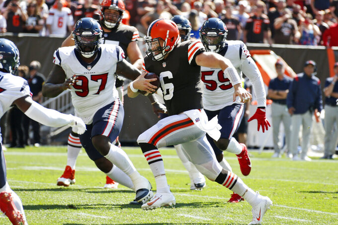 Cleveland Browns quarterback Baker Mayfield (6) scores a 5-yard touchdown during the first half of an NFL football game against the Houston Texans, Sunday, Sept. 19, 2021, in Cleveland. (AP Photo/Ron Schwane)