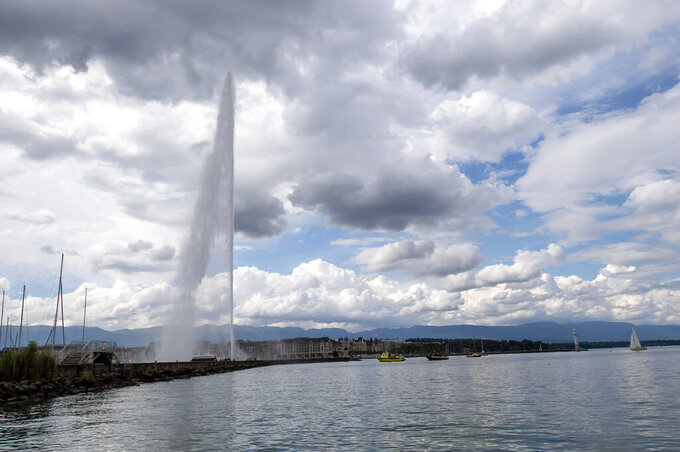 A view of the relaunch ceremony of the famous fountain 'Le Jet d'Eau',  which was postponed due to the coronavirus outbreak, in Geneva, Switzerland, Thursday, June 11, 2020. (Martial Trezzini/Keystone via AP)