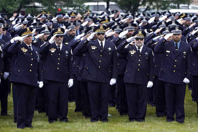 Chicago police officers salute during the playing of Taps after the funeral service for fellow officer Ella French at the St. Rita of Cascia Shrine Chapel Thursday, Aug. 19, 2021, in Chicago. French was killed and her partner was seriously wounded during an Aug. 7 traffic stop on the city's South Side. (AP Photo/Charles Rex Arbogast)