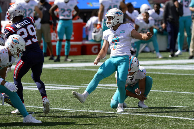 Miami Dolphins place kicker Jason Sanders (7) watches his successful field goal attempt against the New England Patriots in the first half of an NFL football game, Sunday, Sept. 13, 2020, in Foxborough, Mass. (AP Photo/Steven Senne)