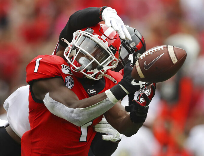 Georgia wide receiver George Pickens can't hold on to a Jake Fromm pass as he is hit by Arkansas State cornerback Jerry Jacobs in what appeared to be pass interference that wasn't called during the first half of an NCAA college football game Saturday, Sept. 14, 2019, in Athens, Ga. (Curtis Compton/Atlanta Journal Constitution via AP)