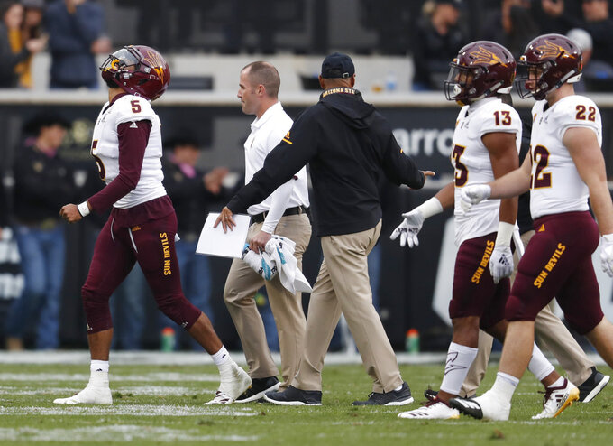 Arizona State quarterback Manny Wilkins, left, heads to the bench after being injured while throwing a pass against Colorado in the second half of an NCAA college football game Saturday, Oct. 6, 2018, in Boulder, Colo. Colorado won 28-21. (AP Photo/David Zalubowski)