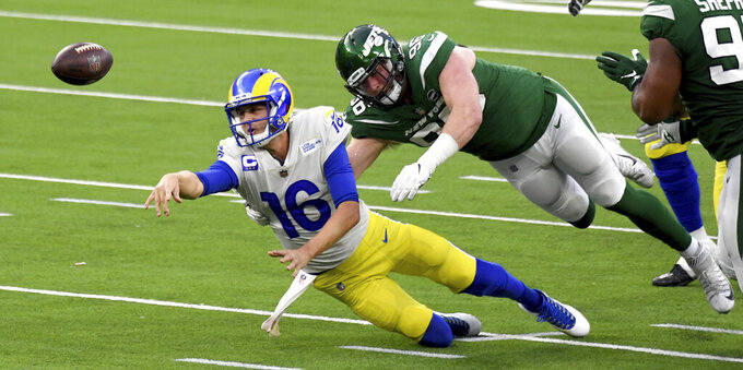 Los Angeles Rams quarterback Jared Goff (16) tries to pass as New York Jets defensive end Henry Anderson (96) makes a tackle in the fourth quarter of an NFL football game in Inglewood, Calif., Sunday, Dec. 20, 2020. (Keith Birmingham/The Orange County Register via AP)